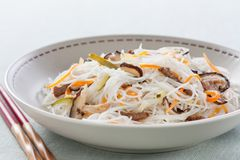 Rice noodles with vegetables, mushrooms and meat Stock Photo