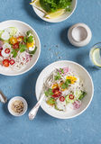 Rice noodles and vegetables salad. Healthy vegetarian food. On a blue background Stock Image