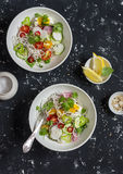 Rice noodles and vegetables salad. Healthy vegetarian food. On a dark background Stock Photography