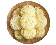 Rice noodles on a wooden plate isolate Stock Photos