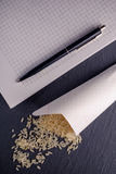 Rice, notebook, dark board. Royalty Free Stock Images