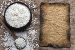 Rice and old paper Stock Photos