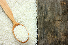 Rice on the old wooden background Stock Image