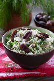 Rice with olives and fresh herbs Stock Image