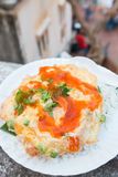 Rice omelet with chili sauce Stock Images
