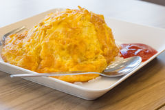 Rice with omelet in the plate Royalty Free Stock Photo