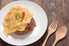 Rice with omelet ,Thai omelet rice on Wood Table stock photo