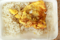 Rice with omelette in foam boxes. Royalty Free Stock Photo