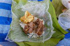 Rice with Omelette and Fried Pork in Banana Leaves Stock Photography