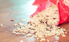 Rice from open pack Royalty Free Stock Photo