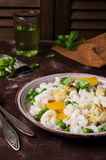 Rice organic pasta. With vegetables and cheese. Selective focus royalty free stock photos