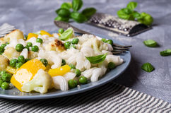 Rice organic pasta. With vegetables and cheese. Selective focus royalty free stock photography