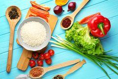 Rice and other products. On wooden table Royalty Free Stock Image