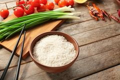 Rice and other products. On wooden table Stock Photo