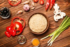 Rice and other products. On wooden table Stock Image