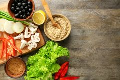 Rice and other products. On wooden background Stock Photo