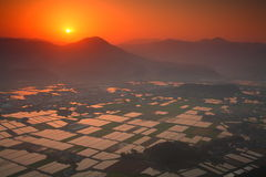 Rice paddies and the morning sun from the summit Royalty Free Stock Photo