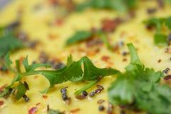 Rice pancake. Macro shot of Rice pancake topped with coriander and mustard seeds Stock Photos