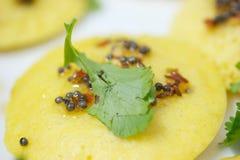 Rice pancake. Macro shot of Rice pancake topped with coriander and mustard seeds Royalty Free Stock Images
