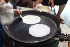 Rice paper being prepared freshly on iron pan Stock Images