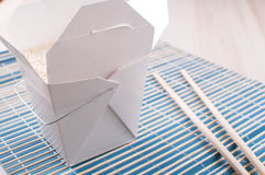 Rice in paper box with chopsticks Royalty Free Stock Photos