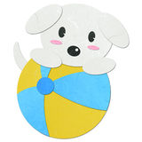 Rice paper cut cute dog with a ball Stock Images