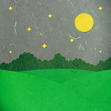 Rice paper cut green field at night. On white background Royalty Free Stock Images