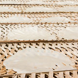 Rice paper drying at a bamboo frame Stock Photo