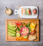 Rice paper rolls with vegetables ingredients and peanut dip. Top view Stock Image