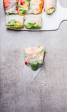 Rice paper rolls wrapping on gray stone background. Top view Stock Image