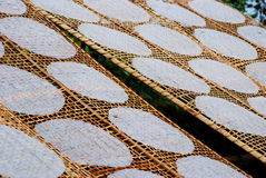 Rice paper spread out in the sun, Vietnam Stock Photo