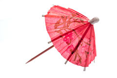 Rice paper umbrella decoration. For cocktail glass, isolated Stock Image