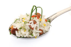 Rice with parsley and mushroom. S on spoon Royalty Free Stock Photography