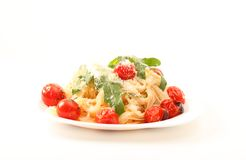 Rice pasta with cherry and arugula Royalty Free Stock Photo