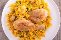 Rice, pea and chicken leg Royalty Free Stock Photos