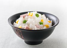 Rice with peas, sweet corn and ham Stock Images