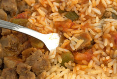Rice peppers and beef chunks with fork close view Stock Image