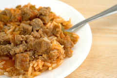 Rice peppers and beef chunks on a plate with fork Stock Images