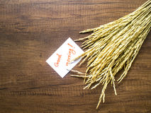 Rice and piece of paper with text 'good morning' on the wooden table close-up Stock Images