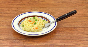 Rice pilaf with fork on wood tabletop Stock Images