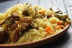 Rice pilaf with lamb closeup Stock Photos