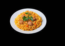 Rice pilaf with lamb meat and vegetables isolated on black. The Rice pilaf with lamb meat and vegetables isolated on black Royalty Free Stock Photos