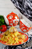 Rice pilaf with meat and vegetables. Traditional middle eastern rice dish with meat, carrots, onions and lots of spices Royalty Free Stock Images