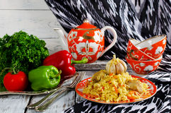 Rice pilaf with meat and vegetables. Traditional middle eastern rice dish with meat, carrots, onions and lots of spices Royalty Free Stock Photography