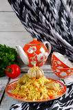 Rice pilaf with meat and vegetables. Traditional middle eastern rice dish with meat, carrots, onions and lots of spices Stock Photo