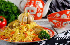 Rice pilaf with meat and vegetables. Traditional middle eastern rice dish with meat, carrots, onions and lots of spices Stock Photos