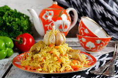 Rice pilaf with meat and vegetables. Traditional middle eastern rice dish with meat, carrots, onions and lots of spices Royalty Free Stock Image
