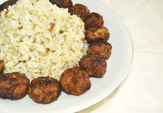 Rice pilaff with baked meatballs Stock Photo