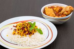 Rice Pilafs Known As Zereshk Polo a Persian Iranian Dish Topped. With Saffron Rice Barberries And Pistachio Served With Flavoring Chicken Meat In Tomato Sauce Stock Photo