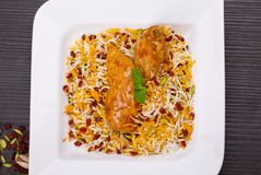 Rice Pilafs Known As Zereshk Polo a Persian Iranian Dish Topped. With Saffron Rice Barberries And Pistachio Served With Flavoring Chicken Meat In Tomato Sauce Royalty Free Stock Photography